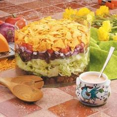 """Taco Salad: """"I found this recipe in an old school cookbook,"""" writes Sandy Fynaardt from New Sharon, Iowa. """"It's always a favorite at potlucks."""" Sandy says she prepares the rest of the ingredients while the ground beef is browning, so dinner is ready in minutes and costs just 83¢ per serving."""