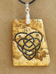 Sandblasted Celtic Mother Knot stone Pendant. $35.00, via Etsy.
