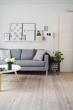 Scandinavian living room with grey IKEA KARSLTAD sofa and Normann Copenhagen Tablo coffee table - Top 10 tips for adding Scandinavian style to your home