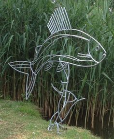 Steel rods and found obects Garden Or Yard / Outside and Outdoor sculpture by artist Ashley Baldwin-Smith titled: 'Lady of the Stream (Steel Rod Large Grayling Fish sculpture/statue)'
