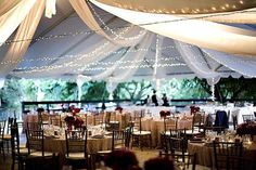 perfect tent/lights for my Great Gatsby/Midsummers Night Dream wedding :)