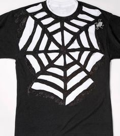 Spider Web T-Shirt instructions: 1. Lay out shirt on flat service. 2. Using masking tape make a spider web outline on front of shirt. 3. Cut out the spaces without tape using scissors. 4. After all spaces are cut, carefully remove tape. 5. Stretch cut spaces to make edges curl slightly. 6. Wear black shirt over white shirt.