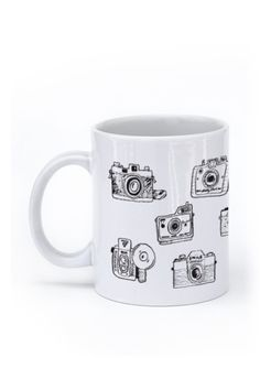 A vintage way to start your day, with this awesome hand drawn vintage camera set mug. - Ceramic - Dishwasher and Microwave safe - Double sided print - 11 oz or 15 oz - White, glossy Processing time: 2