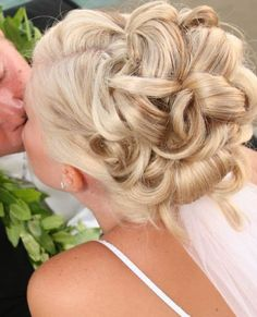 Would love this hair style with flowers in it to match wedding colors