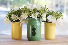 silhouette mason jars - the ideas are endless.  I could also see painting your design on with black paint.