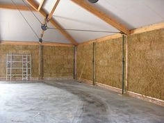 The straw bale wall from the interior before lime rendered