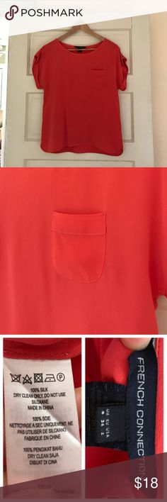 """French Connection Silk Blouse 100% Silk Cap Sleeve Blouse with Pocket. Beautiful coral color. Cuffed Sleeve. 22"""" long from shoulder to bottom hem. 17"""" across at under arms. Purchased at a boutique. Freshly dry cleaned. French Connection Tops Blouses"""