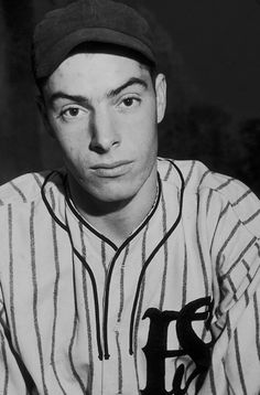 Joe DiMaggio poses for a portrait in his San Francisco Seals uniform in Joe Dimaggio, American Baseball League, Lou Gehrig, New York Yankees Baseball, Mlb Players, Spring Training, March Madness, College Basketball, Sport Girl