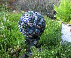 Recycles bowling ball garden art