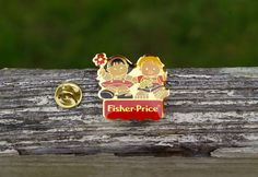 Fisher-Price Toys Boy Girl Flower Frog Gold Tone Metal Enamel Lapel Pin Pinback