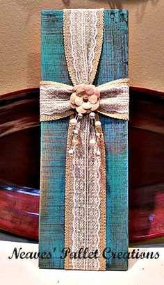 "RECYCLED WOOD PALLETS: Here is another Sweet Rustic Burlap Cross. These are larger than the ones we previously made. These are 16""-16.5"" tall and 6"" wide. They are both embellished with paper rosettes and the teal Cross has a sprig of pearled beads. We are selling these for $12 each. Message us if interested in purchasing one of these Crosses. Share our post with friends if you think they would like them too.  Item #820"