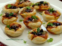 Mini deep dish pizzas in a muffin tin - great for parties too!