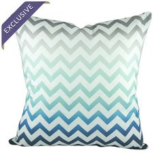 Showcasing a chevron motif and blue and gray ombre hue, this eye-catching handmade pillow adds a plush pop of pattern to your sofa or favorite arm chair