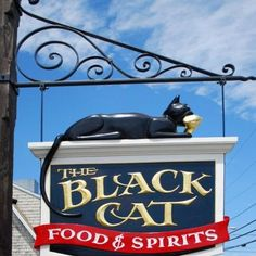 The Black Cat Food and Spirits Tavern Sign