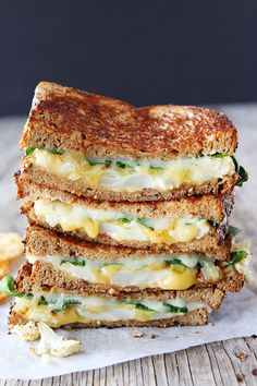 Roasted Cauliflower Grilled Cheese Recipe on twopeasandtheirpod.com Roasted cauliflower, onions, arugula, lemon mustard ailoi, and lots of cheese! This grilled cheese is amazing!