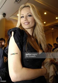Slovak-born top model Adriana Karembeu displays a skin jewel on her arm featuring and supporting Paris for the 2012 Olympics at the Montaigne Auction House in Paris late 13 July 2005, before a sale of personal items belonging to high ranked sportsmen which profit will be given to tsunami victims.