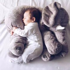 Large Cotton stuffed animal used to snuggle and sleep comfortably Adorable elephant style NOTE- Please watch small children while sleeping to avoid suffication.