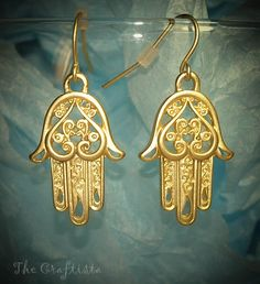 Hamsa Dangling Earrings  -- 25 mm Muted Gold --. $5,99, via Etsy.