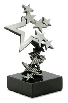 This trophy with its unique interlocking stars makes for a spectacular design. The stars at the base of the trophy climbing on top of each other to reach the main focal point being the bigger star which then turns into more out leading stars looks very nice. It also somewhat reminds me of trophies that involve the southern cross.