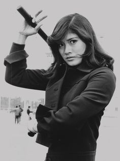Sue Shiomi, star of the remarkable SISTER STREET FIGHTER series, is as beautiful as she is deadly.