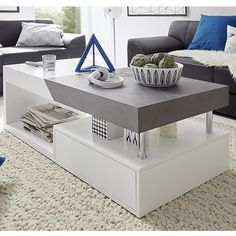 Tuna Storage Coffee Table Rectangular In Matt White And Concrete Effect, is a modern coffee table fits into any home decor. The well design combination of matt white and concrete decor makes it sty...