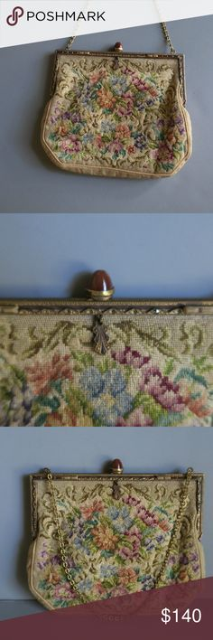 Antique Petit Point Small Floral Needlepoint Bag Beautiful floral petite point/needlepoint evening bag. No stains or tears, inside or out. Chain and clasp in perfect condition, clasp appears to be some sort of stone or wood. Bag measures 6.5 inches at widest point by 5 inches tall. Metal frame has engraved detail - front has small crystal accents with some missing. I have no idea how old this purse is, we came by it when my mother in law died at the age of 98.  For those in the ultra chic…