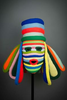 UNTITLED (Mask)/ Deborah Berger (1956–2005, United States), East Windsor, New Jersey, before 1984, knitted Orlon, 26 1/2 x 33 1/4 x 13″, Collection American Visionary Art Museum, Baltimore, gift of the Art Council of New Orleans, FIC.2014.67. Photo by Mary Dwan, © American Visionary Art Museum.