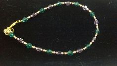 Purple and green beaded memory wire bracelet