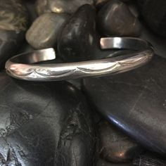 Navajo Sterling Native American cuff 925 bracelet Beautiful solid Navajo Sterling Native American cuff bracelet.  This bracelet is solid... It features traditional Navajo designs all the way around the cuff.  Nice for stacking... Beautiful piece Vintage Jewelry Bracelets