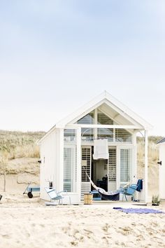 I'm pretty enchanted by Katwijk aan Zee's little cottage on the beach in the Netherlands. When I was growing up in California, we often camped at the beach. Usually it was a small hike to the shore, but once we actually stayed on the sand, and it was fantastic...