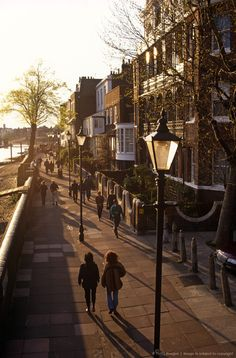 England, London. Walking beside the River Thames near to Hammersmith Bridge.