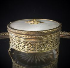 A personal favorite from my Etsy shop https://www.etsy.com/listing/263989360/antique-jewelry-box-ormolu-dish-vanity