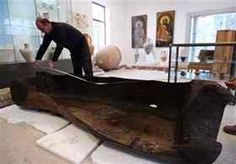 Archaeologist Dimitar Nedkov, measures the length of a well-preserved wooden vessel, likely dating back to the prehistoric age discovered at the bottom of the Black Sea