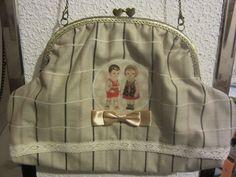 Bolso de boquilla estilo vintage.