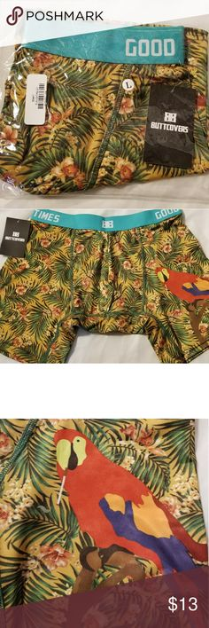 """Tropical Paradise  Boxer Brief Large Butt Covers New in package men's boxer briefs from Butt Covers. A tropical paradise pattern, green leafy palm leaves and tropical flowers featuring a large red/multi colored parrot on the left leg. Has a wide turquoise color waistband  with """"Good Times"""" in black print on each side, and the Butt Cover logo in tje center. Size Large. Butt Covers Underwear & Socks Boxer Briefs"""