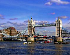 Tower Bridge is a combined bascule and suspension bridge in London. The bridge crosses the River Thames close to the Tower of London and has become an iconic symbol of London. Tower Bridge is one of five London bridges now owned and maintained by the Bridge House Estates, a charitable trust overseen by the City of London Corporation. It is the only one of the Trust's bridges not to connect the City of London directly to the Southwark bank, as its northern landfall is in the Tower Hamlets