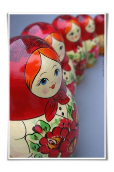A gorgeous ruby red headscarf clad set of classic Russian nesting dolls.