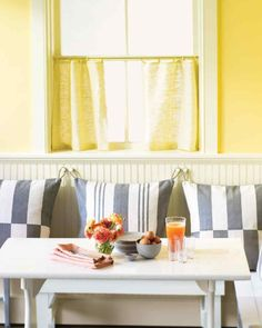 Hanging Pillows Add comfort and color to a dining nook with pillows that hang from knobs on the wall.