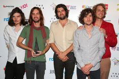 Tame Impala with their ARIA in the press room.