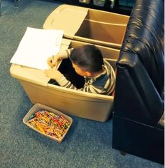 Buckets transformed into seating/workspace. Genius! Great for children with ASD, space, or sensory issues.
