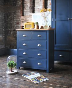 Modern mixed with classic – blue shaker style and a bold Revival radio.