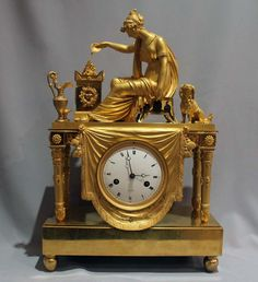 Женщина у алтаря любви dated 1810. Antique French Empire clock of woman at altar of love.