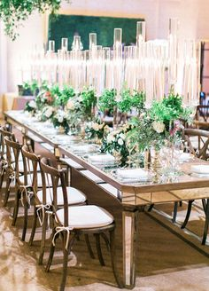 Tables were covered in tall lucite candelabras and mercury glass floral vessels overflowing with stunning textural arrangements. Check out this beautiful real wedding: