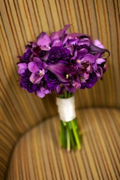 Purple Bouquet: Calla Lilies, Orchids, and Lisianthus. Nice pick of purple flowers, don't care for the calas though. Cover those stems! Purple Calla Lilies, Calla Lily Bouquet, Purple Flowers, Purple Carnations, Lilies Flowers, Purple Orchids, Flower Boquet, Purple Lily, Purple Ribbon
