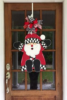 Santa wooden door hanger What a sweet, cheery face to have hanging on your door to welcome family and friends to your home during the