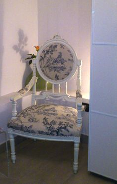 Antique blue & white bedroom chair. Amoretto room at Ospiti Bed and Breakfast, Italy.