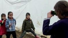Syrian refugee children photograph their lives in camps: 'The camera is better than the rifle.' - Omar Msaid (child photographer)