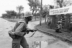 https://flic.kr/p/fqYzEf | Hue 1968 | U.S. Marines with machine guns ready, watch for enemy snipers on a street in Hue on February 7th. Allied dive bombers and U.S. warships bombarded a Communist suicide battalion in Hue's walled fortress on February 15th, and American Marines and south Vietnam black panther troops charged into the flaming ruins to wipe out the Viet Cong.