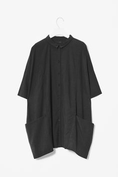 Oversized shirt - small collar with pockets on your hips. You are creating an illusion that is not flattering. Time to go!