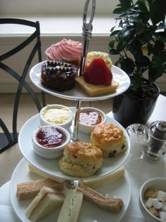 "and have your friends for ""High Tea"" . Polish the best silver, get the bone china from storage, iron the lace table cloth and set up the food. Sandwiches on the bottom plate are eaten first, then the cream scones and end with the ""dessert cakes""."